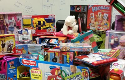 IQ Inc.'s 2015 Toys for Tots donation